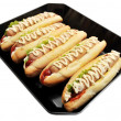 Hot dogs on a pan on white — Stock Photo