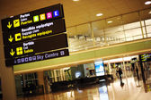 Yellow sign at a international airport — Stock Photo
