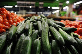 Cucumbers and tomatoes on the market — Stock Photo