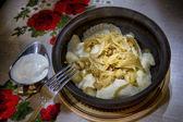 Tasty dumplings with fried onion — Stock Photo