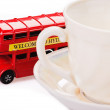 Bus and cup — Stock Photo