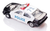 Toy police car with insignia — Stock Photo