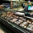 Fully loaded shelves with fish in a large supermarket — Stock Photo