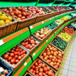 Shelves with vegetables in a shop — Stock Photo