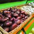 Stock Photo: Pattern red onions in market