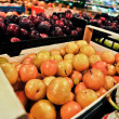 Plums at the grocery store — Stock Photo