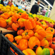 Orange peppers at the store — Stock Photo