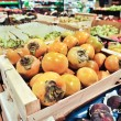 Persimmons in store — Stock Photo