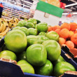 Green pomelos in boxes in supermarket — Foto Stock