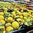 Stock Photo: Bunch of yellow quince in supermarket. Wide angle shot