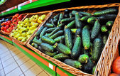Greenhouse cucumbers in the market — Stock Photo