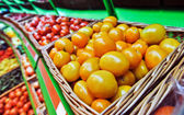 Fresh tomato at a farmer's market — Stock Photo