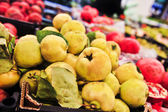 Bunch of yellow quince in supermarket. Wide angle shot — Stock Photo