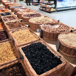 Various dried fruits and nuts in market — Stock Photo