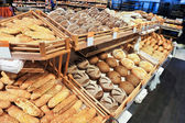 Variety of baked products at a supermarket — Стоковое фото