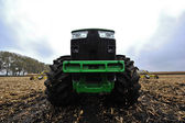 Tractor on the field — Stock Photo