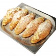 Croissants with almonds in bowl — Stock Photo #42001407