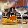 Still life with cheese and wine — Stock Photo #42001425