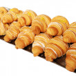 Croissants with almonds in bowl — Stock Photo #42001469