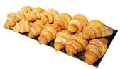 Croissants with almonds in a bowl — Stock Photo