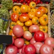 Yellow and red tomatoes in the supermarket Beefsteak with artichokes — ストック写真