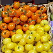 Fresh red and yellow cherry tomatoes at the market — Stock Photo #44249243