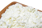 Cottage cheese in a bowl on a white background — Stock Photo