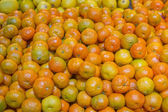 Bunch of fresh mandarin oranges on market — Foto Stock