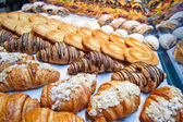 Croissants and cake at the bakery — Stock Photo