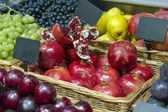 Ripe pomegranates on the market and supermarket — Stock Photo