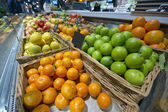 Citrus tangerines, lemons, limes and oranges at the market — Stock Photo
