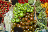 Kumata black tomatoes in the supermarket and bazaar — Stock Photo