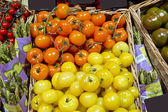 Fresh red and yellow cherry tomatoes at the market — Stock Photo