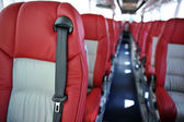 Red leather seats  in a tourist bus — Stock Photo