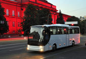White tourist bus of city lights — Stock Photo