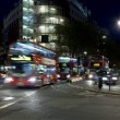 Double deckers driving through crossroads in London, England — Stock Photo