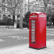Stock Photo: Red phone booth in London, UK.