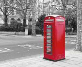 Red phone booth in London, UK. — Stock Photo