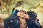 Happy family in autumn forest photo — Stock Photo