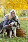 Beautiful girl with dog — Stock Photo