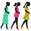 Silhouettes of pregnant woman — Stock Vector #14509309