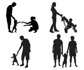 Silhouettes of families with children — Stock Vector