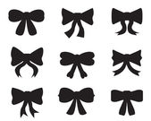 Set of silhouettes of bows — Stockvector