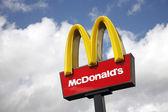 McDonalds logo on blue sky background — Stock Photo