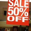 Photo: Sale signs in shop window