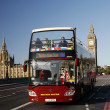 London tour bus passing on Westminster bridge — Stock Photo