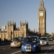 Stock Photo: London Taxi on Westminster Bridge