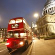 Stock Photo: London Routemaster Bus and St Paul's Cathedral at night