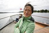 Woman on a tour boat, Lake District — Stock Photo