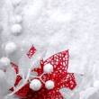 Christmas white seasonal background with snow, beads and red tin — Stock Photo #16530437